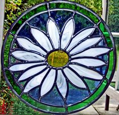 This round window was made for a Bristol house, using opal/blue streaky glass for the delicate petals of the daisy