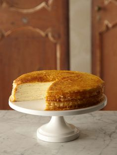 Crepes Cake - crepes layered with pastry cream and topped with a caramelized sugar http://www.epicurious.com/recipes/food/views/Grand-Marnier-Crepe-Cake-241754