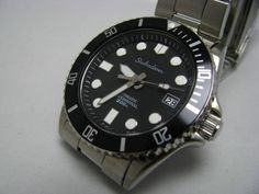 SKX033K PMMM PMMM dial + Type S hands +Rollie style bezel insert: US$235. Coated domed sapphire is US$45 installed but can't stick a magnifier on the domed sapphire.  http://s161.photobucket.com/user/yobokies/media/Mods/IMG_9041.jpg.html?sort=6&o=218