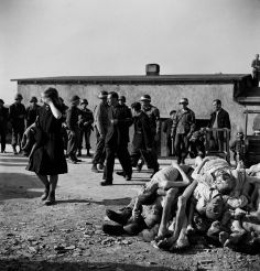 German civilians are forced by American troops to bear witness to Nazi atrocities at Buchenwald concentration camp, mere miles from their own homes, April 1945.