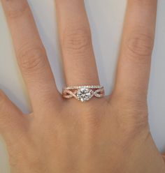 This listing feature a gorgeous rose gold wedding set, including an infinity twist engagement ring and accompanying wedding band. The engagement ring