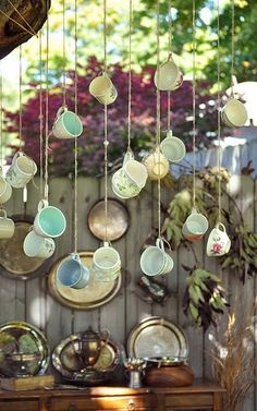 Using vintage teacups strung as steampunk wedding decor or a way to show off a collection you may own