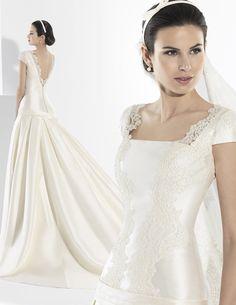 Vestido de novia de corte clásico y corte en cadera en mikado francés.