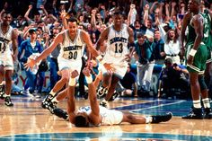 Alonzo Mourning celebrating after winning shot against Boston Celtics.