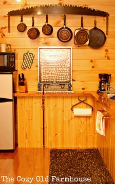 """The Cozy Old """"Farmhouse"""": Cutest {Junkiest} Vintage Cabin. Love the saw used as a pot hanger! Rustic Kitchen, Vintage Kitchen, Kitchen Decor, Kitchen Ideas, Kitchen Small, Kitchen Hooks, Kitchen Supplies, Kitchen Stuff, Country Kitchen"""