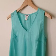 ☀️ New with tag High Low Mint Chiffon Top This top is so beautiful! The color is a perfect mint, almost Tiffany Blue. This top looks great with a pair of skinny white jeans and heels.  This is a size small but could definitely fit an XSmall too.  Please note the small flaw in the last picture. There's a small hole from where the sensor used to be.  Bundle and save anywhere between 10-40% off the listed price. Tops Tunics