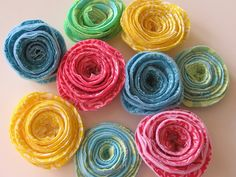 Fabric rolled flower tutorial -- I've done paper ones but never fabric like this! Love em!