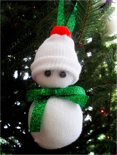 #DIY Baby Sock Snowman Ornament. We're obsessed! #Christmas