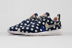 "Following on from the Air Max 90, Nike present a new addition to the ""NYC"" City Pack, with a new makeup of the highly successful Roshe Run. Paying homage to the city's vacationers with a canvas upper and nautical-flags adorned pull tab, the lightweight sneaker has been given a bold allover polka dot pattern. Suede boat style laces complete the vacation theme of the summertime sneaker."