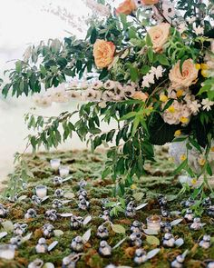 An Elegant, Intimate Wedding on Long Island | Martha Stewart Weddings - The bride wrote all of the names and seating assignments on the escort cards, which were then attached to bird-shaped bottle openers as a reference to her middle name of Finch. #weddingideas #wedding #seatingcards