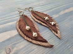 Brown Earrings. Long Feather Earrings. Bohemian Earrings. Bohemian Jewelry. Long Leather Feather Earrings. Boho Tribal Earrings. Hippie Earrings. Materials: genuine leather,bronze jewelry findings,howlite beads. Colour: brown,beige,bronze. Full length with hooks: 9.5 cm( 3.75) If you