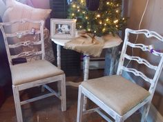 Creamy white distressed matching table & chairs.  Burlap covered cushions are a great neutral