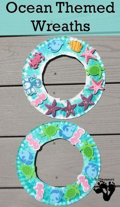 Ocean Themed Craft. Using a paper plate with the center cut out, children paint the ring blue (add glue to the paint) and then stick different ocean animals around the circle.