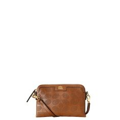 Orla Kiely: Soft leather bag with punched Sixties Stem detail on front and back. Zip to close. Gold colored hardware. Long detachable leather strap. Inside details include cream jacquard lining, small zip pocket and mobile pocket.