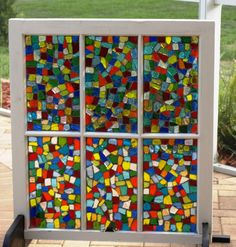 Stained glass mosaic on old window......