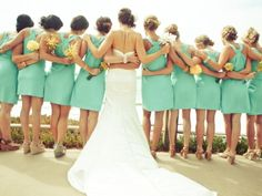 Beautiful short aqua colored bridesmaid dresses. Whether they're tall or short heeled shoes youre always going to have the problem of your shoes sinking into the grass. Prevent that from happening wih high heel caps that would keep your shoes from sinking into the grass.