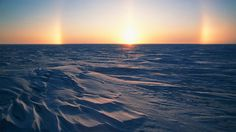 """Fairbanks, Alaska. 'Sundog' is a unique rainbow created by the reflection of light through ice crystals rather than water drops — either crystals in high-altitude cirrus clouds or lower-elevation crystals called """"diamond dust."""" Arctic and sub-Arctic environs are the prime locations for viewing the brightest and most conspicuous sundogs that derive from diamond dust. Low-angle sunlight enhances the brilliance of the effect, and Fairbanks in late winter is an ideal locale."""