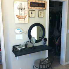 When we moved into our new home a few weeks ago there was absolutely no good place to put my makeup vanity.  It was too big, and I couldn't find a replacement that was narrow enough anywhere.  I had only three feet of wall and roughly one foot depth to work with.  So, using a staircase riser painted black as a tabletop, three metal brackets, and a round mirror I got for $9.99, I made my own.