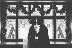 We love this photo of the bride and groom silhouetted by our stained glass windows and holiday decor! Willowdale Estate, a weddings and events venue north of Boston, Massachusetts. WillowdaleEstate.com | Rachel Buckley Photography