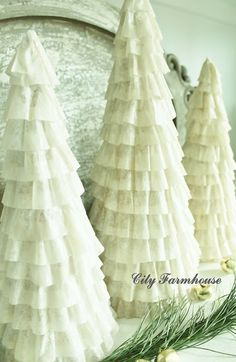 DIY Coffee Filter Christmas Trees Tutorial from City Farmhouse (love this! would paint cones white so paper mache doesn't show through)