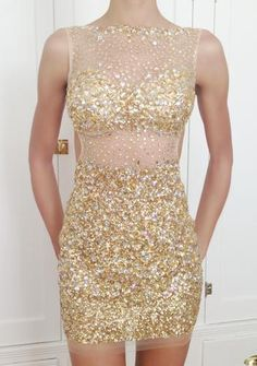 www.pageantresale.com - This dress is glamorous, body con and fitted. Low-cut back. Covered in glittering rhinestone jewels from top to the mini length hem, this an incredible dress. Even better in person. Lining in bust plus removable push up cups added. Show stopper! LIKE NEW, worn one time onstage. Not altered. Retail $690. Contact if you have any questions!