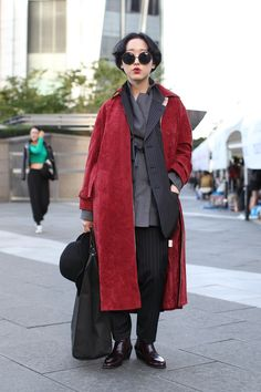 Notepads Out! 20 Next-Level Seoul Street-Style Snaps #refinery29  http://www.refinery29.com/2013/10/55989/seoul-korea-fashion#slide-15  Wearing chalk stripes in a way that's both banker and gangster — hats off.
