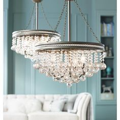 The refined appeal of this chandelier is clear, thanks to a cascade of clear crystal baubles that sparkle when illuminated.