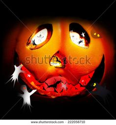 #halloween pumpkin face WITH BATS AND GHOSTS INSIDE - stock photo