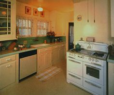 This kitchen had retained the original upper cabinets but the lower cabinets had all been replaced. Using paint found on the wall behind the newer cabinets, new lower cabinets were designed that matched the originals..The original green subway tile backsplash was still there, but the countertop had been replaced with wood-grain laminate. New tile countertops were designed based on a fragment of the old countertop tile that was found in the backyard.