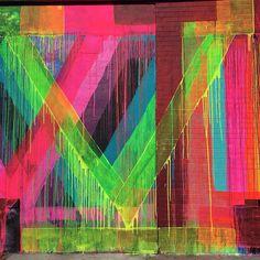 Colorful street art mural from Maya Hayuk in Williamsburg Brooklyn, NYC.