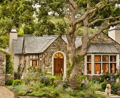 """""""Biddlestone Cottage"""", a charming cottage in Carmel-by-the-Sea, CA. Imported stone from France, slate roof, leaded glass bay window."""