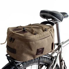 A mostly-padded waxed canvas bag that mounts to a bike rack. Keep your junk in a trunk on a bike. Made at Frost River in Duluth, Minnesota and guaranteed for life. Waxed Canvas Bag, Cycling Outfit, Cycling Clothing, Cycling Bag, Cycling Tips, Road Bike Women, Bike Bag, Bicycle Maintenance, Cool Bike Accessories