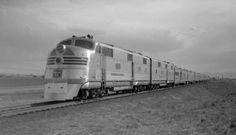 CB&Q train, engine number 9911 + additional diesel units, engine type EMC E5 Train #10, Denver Zephyr, 9 cars, 65 MPH. Photographed: east of Derby, Colo., April 14, 1940.