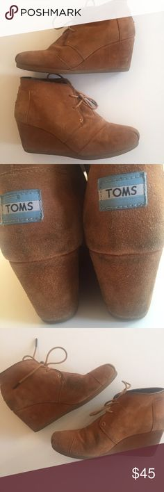 TOMS Tan Desert Wedges These are the most comfortable heeled lace up boots ever! Well loved (pictures show slight wear on inner toes and on heels), there's still a lot of life left in these babies! Make an offer I can't refuse, please! ✌️ TOMS Shoes Heeled Boots