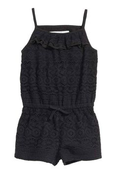 Lace playsuit: Lace playsuit with narrow shoulder straps, an elasticated seam at the waist, short legs and jersey lining.