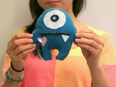 Interactive monster with LEDs by lilypad creator, e-sewing, soft circuit project