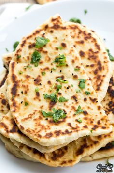 Famous Indian Butter Naan, great with curries and rice! Recipe with step by step pictures.