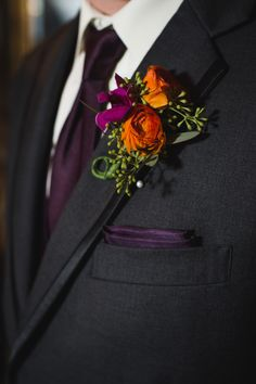 Purple Wedding Flowers Eggplant color tie and pocket square paired with an Autumn hued boutonniere - as featuring on - Small Candle Lit Wedding in the champagne cellar of Biltmore Estate. Flower arrangements by Flower Gallery of Asheville Orange Purple Wedding, Orange Wedding, Burgundy Wedding, Groom Attire, Groom And Groomsmen, Groomsmen Attire Purple, Groomsman Attire, Groom Suits, Wedding Suits