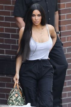 Busting out: Kim Kardashian, 36, put her very ample bosom on show in a skimpy top as she headed to lunch in LA on Thursday