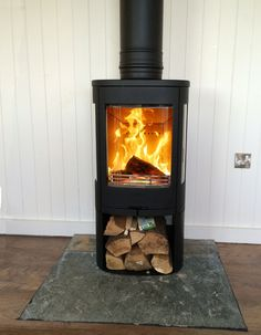 The Contura range of stoves are our first port of call for anyone who has combustible walls. This Contura 850 fits this converted wooden outbuilding perfectly.     #contura #stove #fire #wood #burner #side #windows #modern #contemporary #combustible #log #store #kernowfires #wadebridge #redruth #cornwall