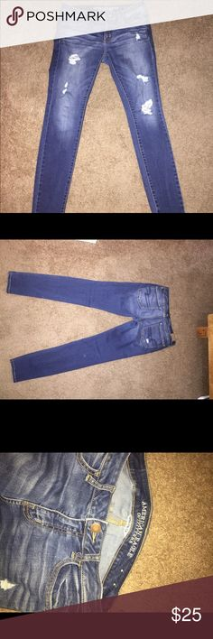 American eagle distressed jeggings super stretch Like new condition size 8 s (short) thought I'd like the distressed look but my son started wanting to pull on the strings so before he could make them holey instead of distressed I decided to take off and sell. My loss your gain American Eagle Outfitters Pants Leggings