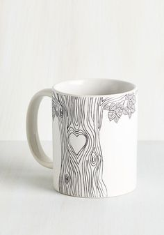 Start the day with a smile while sipping from this 'tree'-riffic white mug! Illustrated with a sketch-like tree trunk - complete with a heart-shaped knot - this swoon-worthy ceramic mug offers a whimsical nod to your love of nature's beauty.