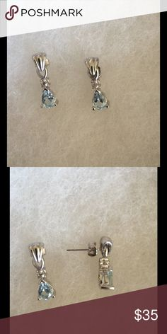 Sterling Silver and Aquamarine Earrings Class, yet eye-catching, these earrings are stunning in their simplicity. Sterling silver, teardrop-cut aquamarine, post backs. Jewelry Earrings