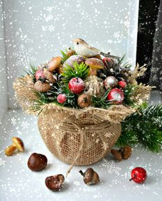 Christmas bird: mushrooms, apples, evergreens, burlap.