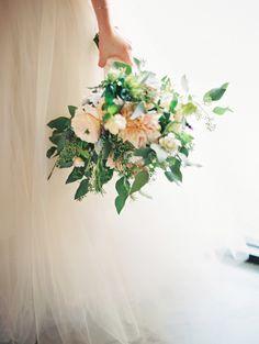 love this bouquet shot, photo by Lavender & Twine http://ruffledblog.com/microbrewed-wedding-inspiration #flowers #peach