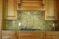 "backsplash...don't like the color but like the idea of an ""inset"" above the stove."