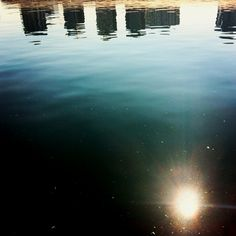 Reflection in the water. Upside down it looks like a city ad the nights sky