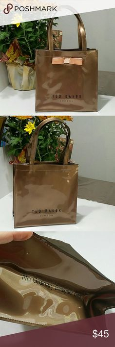 """Ted Baker bag Brown tote with a copper color bow.  Cute carrier bag great for shopping or as a purse.  Completely wipes clean. Measures 9.5x9.75x4.5"""", strap drop is 6.5"""" Never used, only some marks from storage. Ted Baker London Bags"""