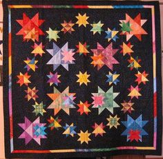 All in the Family Sampler made by Claudia Lash. The pattern is by Judy Martin and is in the book, Knockout Blocks and Sampler Quilts and the Electric Quilt cd-ROM, Star Power. The border is Claudia's own. Great quilt all around!