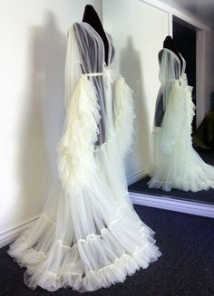 Incredible, floor-sweeping sheer white gown.